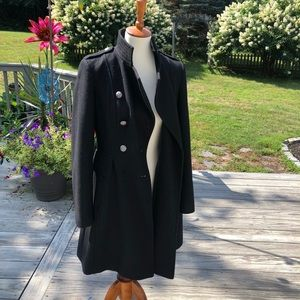 Women's black wool coat size 4 with amazing back.